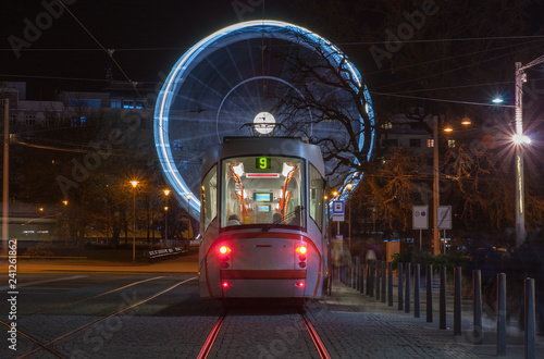 Tram and christmas ferris wheel  at Moravian square in Brno