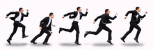 Young Business Man Running And Isolated On White