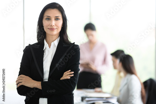 Fotografía  Graceful business woman in black suit standing with dignified manner in office