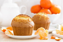 Muffin With Tangerines Closeup On White Background. Sweet Delicious Homemade Baking. . White Background. Wooden Background.