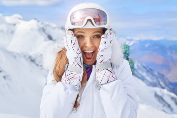 Close up portrait of a woman at a snow ski center.