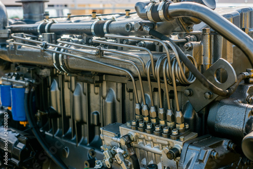 Foto  Metal pump, engine, parts for agricultural machinery.