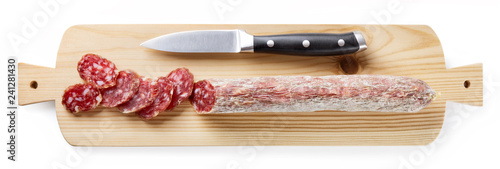 Sliced salami on white background, top view