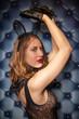 beautiful caucasian girl posing in black lace lingerie and transparent rabbit mask on dark Studio background