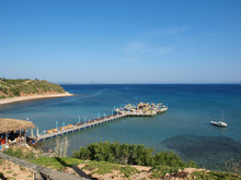 A Jetty With Bar Leading Out To Sea In Altinkum Turkey