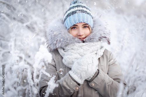 Obraz Beautiful smiling young woman in wintertime outdoor. Winter concept - fototapety do salonu