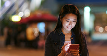Woman Send Sms On Cellphone In...
