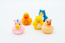 A Group Of Rubber Ducks On An Isolated Background