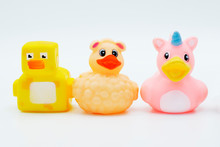 Three Rubber Ducks In A Row Isolated On A White Background