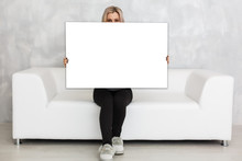 Woman Holding A Blank Board Fo...