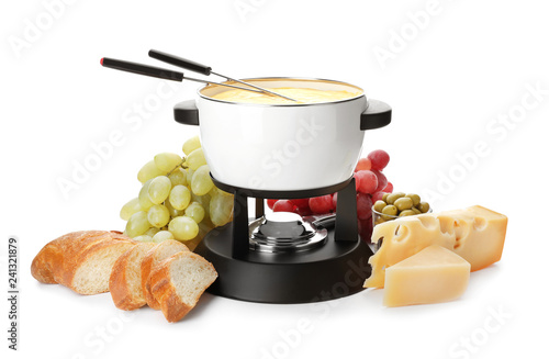 Composition with pot of delicious cheese fondue on white background