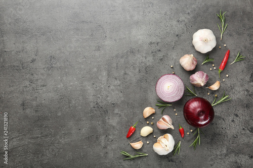 Flat lay composition with garlic, onion and space for text on table