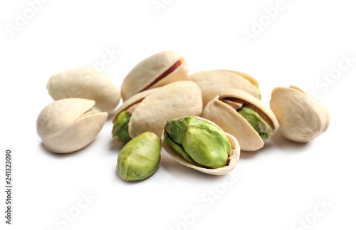 Tasty organic pistachio nuts on white background, closeup