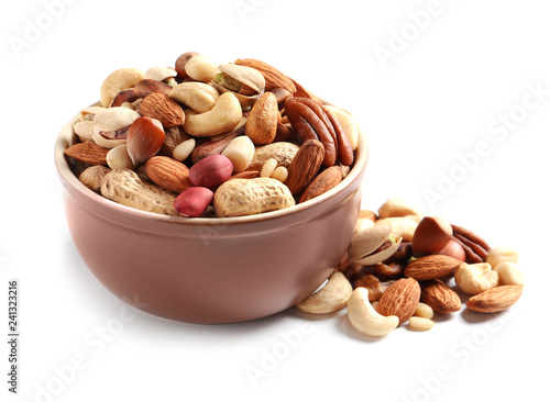 Bowl with mixed organic nuts on white background