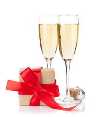 Gift box and champagne glasses