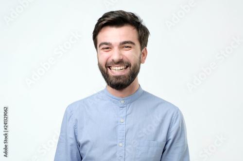 Fotografie, Obraz  Hispanic man wearing blue shirt laughing or grinning having cheerful look