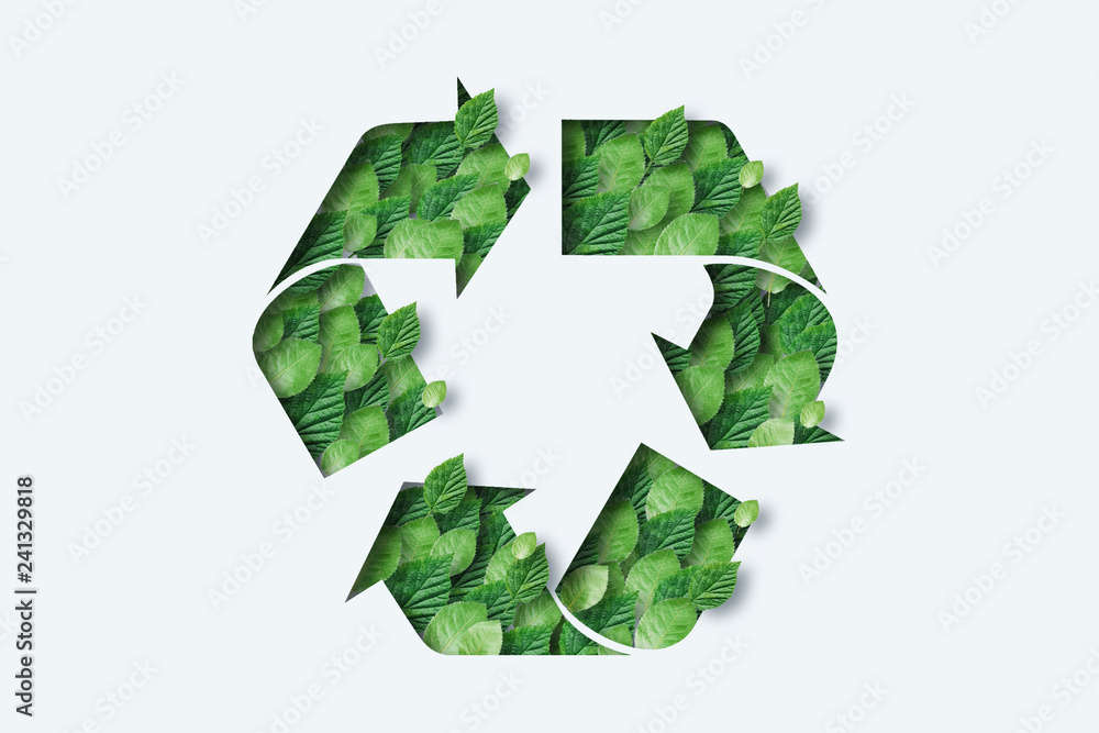 Fototapeta Recycling icon made from green leaves. Light background. The concept of recycling, non-waste production, eco-plastic, eco fuel.
