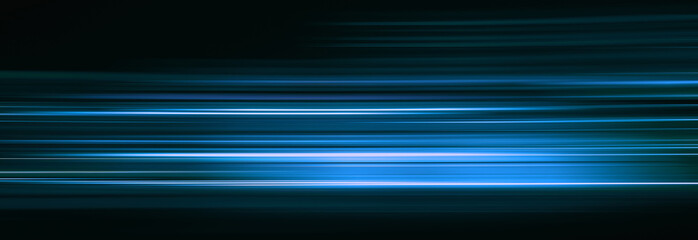 Abstract blue light trails in the dark, motion blur effect