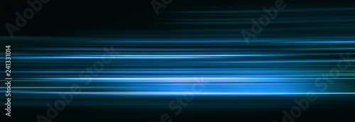 Abstract blue light trails in the dark, motion blur effect Canvas Print