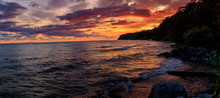 Dramatic Sunrise Along The Shores Of Lake Erie. Amazing Color Reflection From The Sun And Clouds.