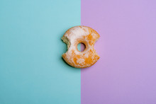 Bitten Donut On Blue-violet Bicolored Background