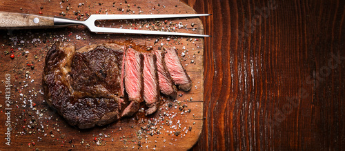 Tablou Canvas tasty and fresh, very juicy ribbey steak of marbled beef, on a wooden table
