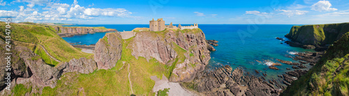 Panorama of a cliff with ancient castle in a bay with blue sky and white clouds Canvas Print