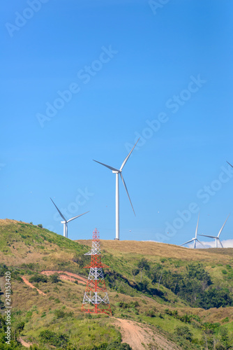 Fotografie, Obraz  wind turbine on mountain making eclectic energy from wind