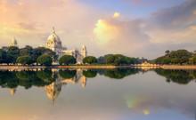 Victoria Memorial With Adjacent Lake At Sunrise With Moody Sky At Kolkata India.