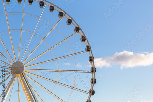 Poster Amusementspark A ferris wheel during a day with blue skyes