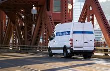 Compact Small Business Cargo Mini Van Going On The Truss Broadway Bridge In Portland