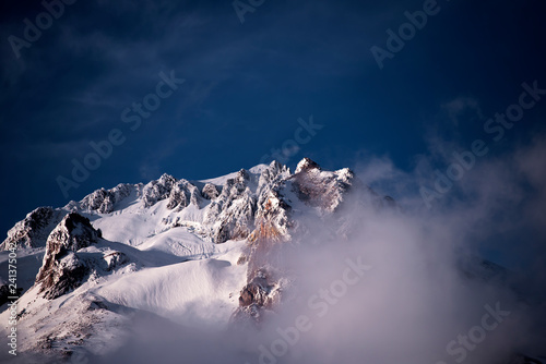 Fotografija  The mysterious Mount Hood peak is covered with snow and clouds at the same time