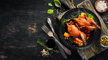Baked Quail. On A Black Background. Top View. Free Space For Your Text.