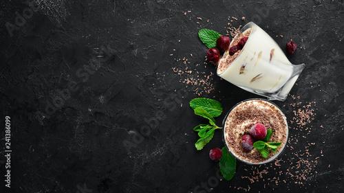 Fototapeta Dessert Tiramisu with cherries. Top view. Free space for your text. obraz