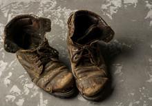 Old Boots On Concrete Background, Vintage Concept