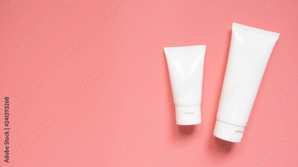 Fototapety, obrazy: Blank white squeeze bottle plastic tube with flip top cap on pink background. Packaging of cream, body lotion, gel, facial foam or skincare. Cosmetic beauty product branding mock-up. Copy space.