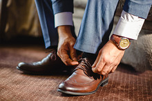 An Elegant Man Puts On Black, Leather, Formal Shoes.