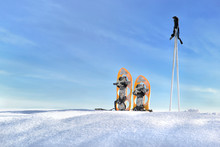 Snowshoes And Sticks On The Sn...