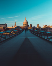 Millennium Bridge St Paul's Cathedral On Modern London City Skyline Blue Sky