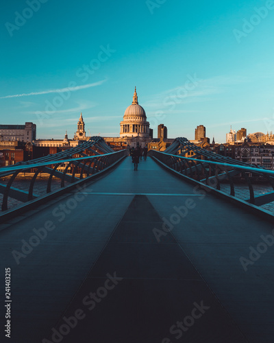 Millennium Bridge St Paul's Cathedral on modern London city skyline blue sky Canvas Print