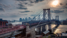 Hazy Sunset Over WIllimsburg Bridge Brooklyn New York City And Hudson River HDR High Dynamic Range