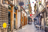 Fototapeta Uliczki - Narrow street of charming Troyes, France