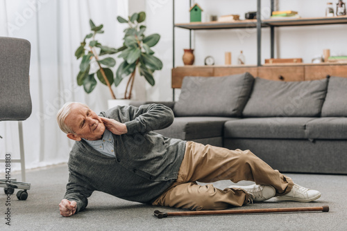 old men falled down on floor and touching neck - 241428883