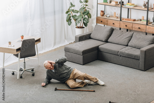 Tablou Canvas old man falled down on floor of the room