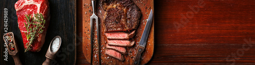 Carta da parati a piece of fresh marbled beef on a wooden background, with spices for cooking st