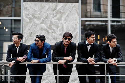 Group of 5 indian students in suits posed outdoor. Canvas Print