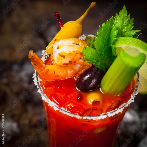Bloody Mary Cocktail with Vodka and Tomato Juice, Tabasco Sauce and Ice Decorated with Celery. Selective focus.