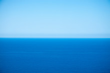 Calm Flat Surface Of Sea And Cloudless Clear Blue Sky At Horison. Near Balos Lagoon. Crete, Greece.