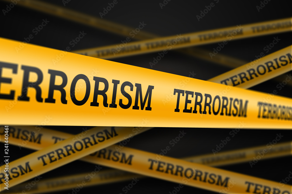 Fototapeta Inscription terrorism on a yellow barrage on a black background. The concept of stop terror, terrorist attack, explosions, attempted.
