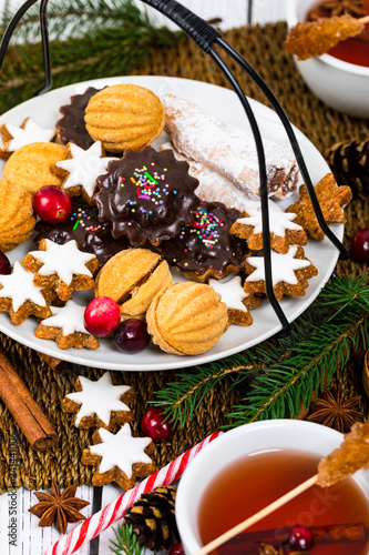 Christmas Tea Time with Background with Assorted Mixed Cookies and Tea. Selective focus.